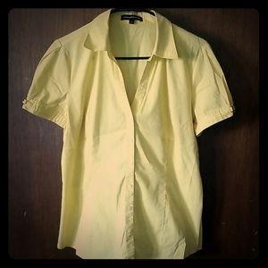 Yellow button up shirt